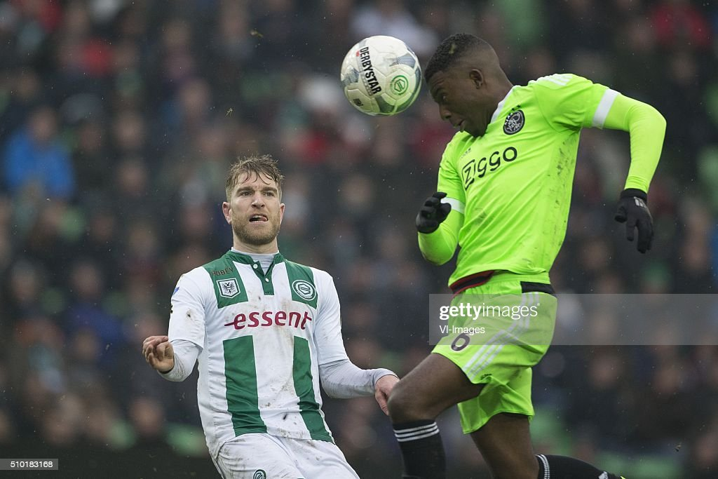 , Ajax, Michael de Leeuw of FC Groningen, Riechedly Bazoer of AFC Ajax, during the Dutch Eredivisie match between FC Groningen and Ajax Amsterdam at Euroborg on February 14, 2016 in Groningen, The Netherlands