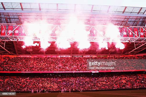 Ajax players and fans watch the fireworks as the new Champions flag is added to the roof of the stadium during the Eredivisie match between Ajax...