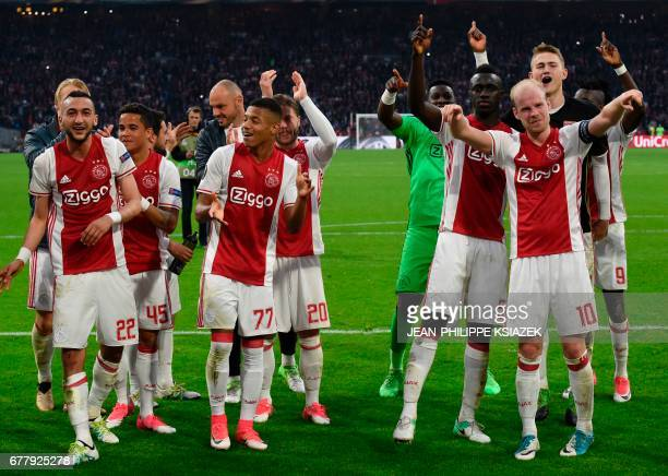 Ajax players celebrate after the 41 victory in UEFA Europa League semifinal first leg Ajax Amsterdam v Olympique Lyonnais on May 3 2017 in Amsterdam...