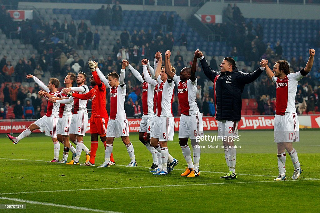 Ajax players celebrate after victory in the Eredivisie match between Ajax Amsterdam and Feyenoord Rotterdam at Amsterdam Arena on January 20, 2013 in Amsterdam, Netherlands.