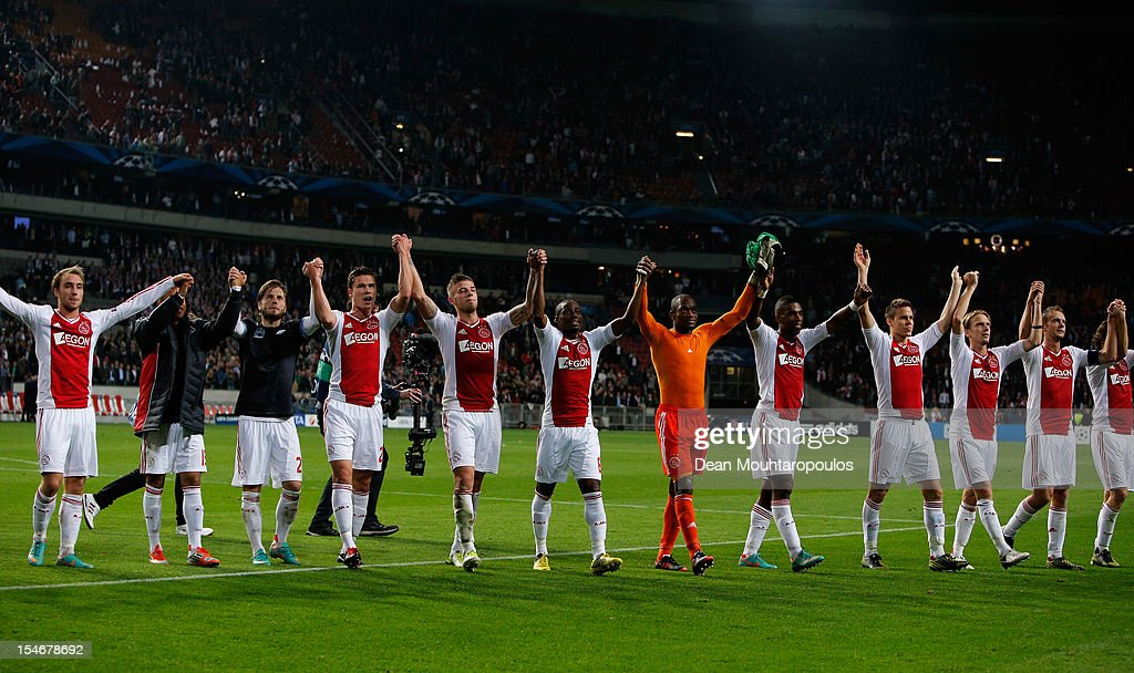 Ajax players celebrate after victory in the Group D UEFA Champions League match between AFC Ajax and Manchester City FC at Amsterdam ArenA on October 24, 2012 in Amsterdam, Netherlands.