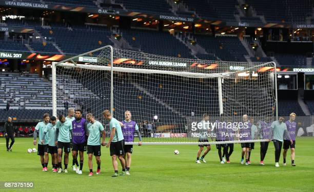Ajax players lift a goal during the training session at the Friends Arena Stockholm in Sweden ahead of the Europa League Final against Manchester...