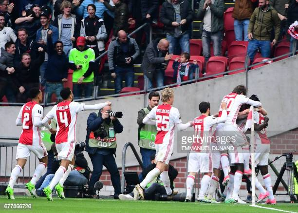 CORRECTION Ajax players react after Ajax defender Davinson Sánchez scored a goal during UEFA Europa League semifinal first leg Ajax Amsterdam v...