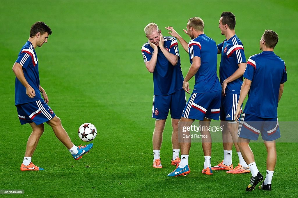 Ajax players share a joke during a training session ahead of their UEFA Champions League Group F match against FC Barcelona at Camp Nou Stadium on October 20, 2014 in Barcelona, Spain.