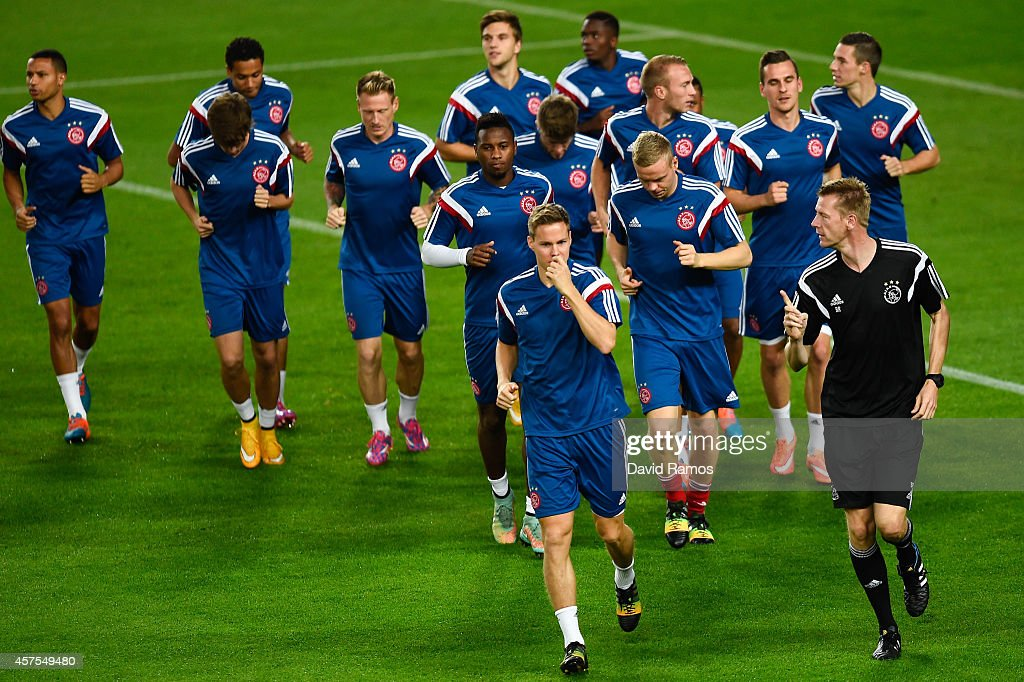 Ajax players warm up during a training session ahead of their UEFA Champions League Group F match against FC Barcelona at Camp Nou Stadium on October 20, 2014 in Barcelona, Spain.