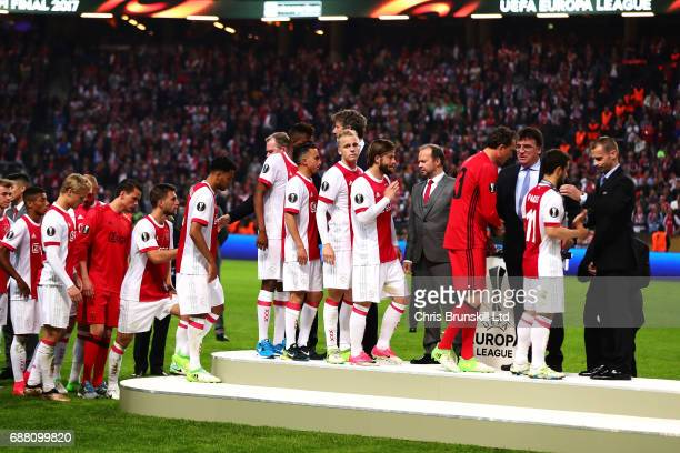 Ajax receive their runners up medals following the UEFA Europa League Final match between Ajax and Manchester United at Friends Arena on May 24 2017...