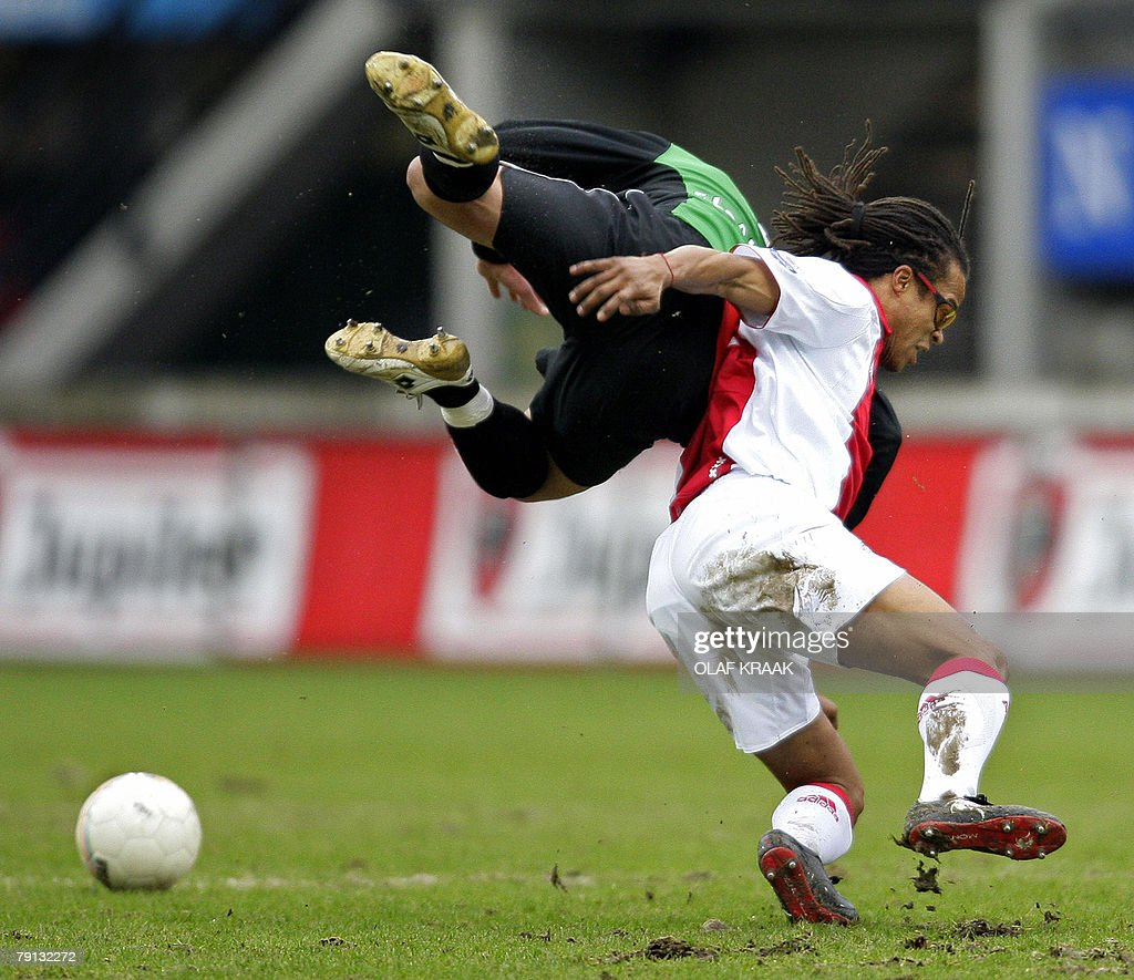 Ajax 's Edgar Davids in duel with Youssef ElAkchaoui of NEC as part of the Netherlands First Division soccer match held in Nijmegen 20 January 2008...