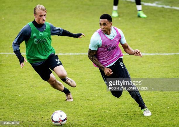 Ajax's Danish forward Kasper Dolberg and Dutch defender Kenny Tete take part in a training session in Amsterdam on May 18 ahead of the team's Europa...