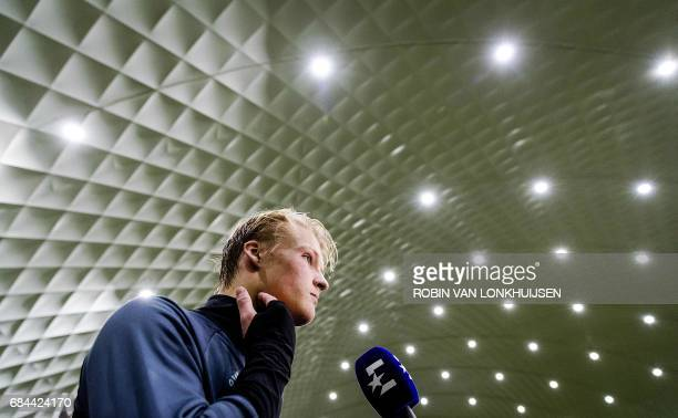 Ajax's Danish forward Kasper Dolberg looks on during a press conference in Amsterdam on May 18 ahead of the team's Europa League final football match...
