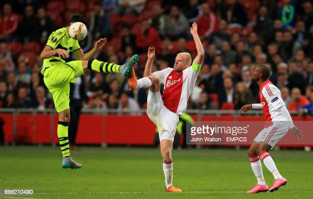 Ajax's Davy Klaassen battle for the ball with Celtic's Nir Biton