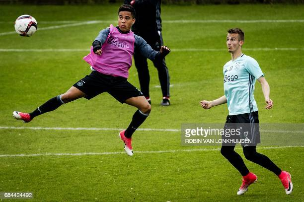 Ajax's Dutch forward Justin Kluivert and Czech forward Vaclav Cerny take part in a training session in Amsterdam on May 18 ahead of the team's Europa...