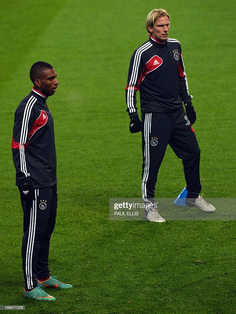 Ajax's Dutch forward Ryan Babel (L) and Danish midfielder Christian Poulsen take part in a training session at The Etihad Stadium in Manchester, north-west England, on November 5, 2012. Ajax take on Manchester City in their UEFA Champions League Group D football match on November 6.