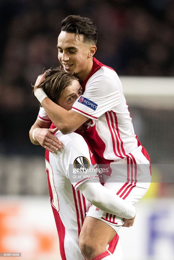 Ajax's Dutch midfielder Abdelhak Nouri (R) and Danish midfielder Lasse Schone celebrate after a goal during the UEFA Europa League Group G football match between Ajax Amsterdam and Panathinaikos at the Amsterdam Arena in Amsterdam on November 24, 2016. / AFP / ANP / Olaf KRAAK / Netherlands OUT