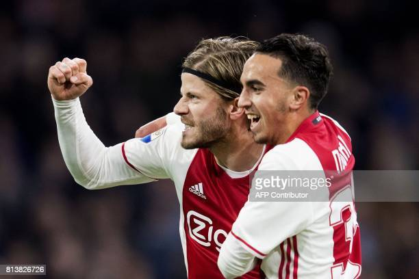 Ajax's Dutch midfielder Abdelhak Nouri and Lasse Schone react during a football match on April 5 2017 in Amsterdam Abdelhak Nouri has suffered...