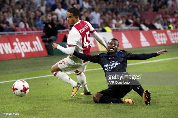 Ajax's forward Justin Kluivert fights for the ball with OGC Nice's midfielder Jean Seri during the Champions League second leg football match between...