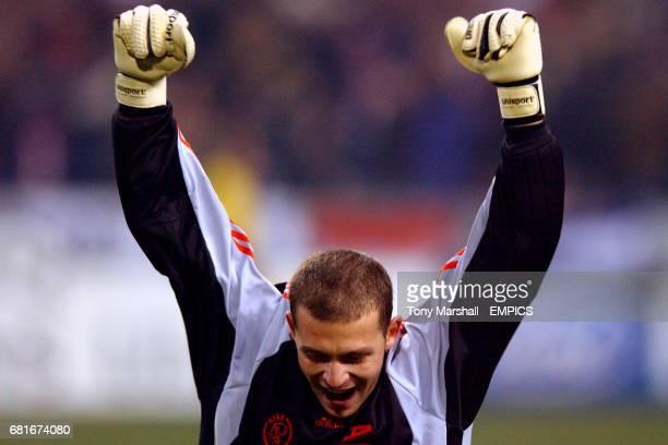 Ajax's goalkeeper Bogdan Lobont celebrates Zlatan Ibrahimovic's goal