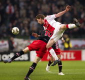Ajax's Jan Vertonghen duels for the ball with Danny Koevermans during the Premier League soccer match against PSV in Amsterdam The Netherlands March...