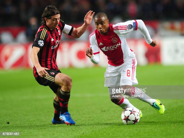 Ajax's Lerin Duarte and AC Milan's Riccardo Montolivo battle for the ball