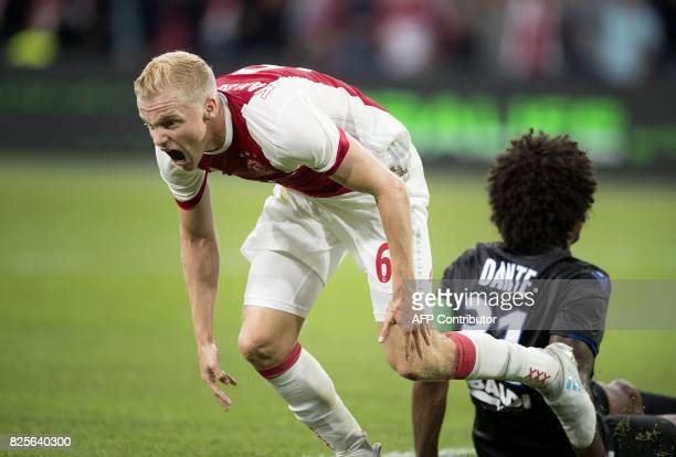 Ajax's midfielder Donny van Beek reacts after scoring during the Champions League second leg football match between OGC Nice and Ajax in the ArenaA...