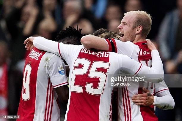 Ajax's players celebrate a goal during the Dutch Eredivise football match between Ajax Amsterdam and FC Utrecht at The Amsterdam ArenA in Amsterdam...