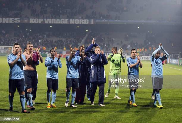 Ajax's players gwave to their fans after the Champions League football match Olympique Lyonnais vs AFC Ajax on November 22 2011 at the Gerland...