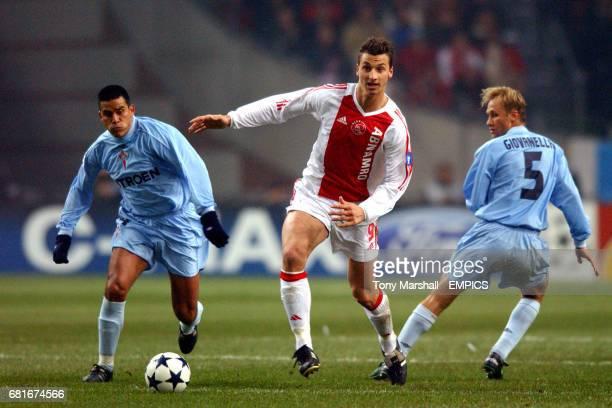 Ajax's Zlatan Ibrahimovic takes on Celta Vigo's Everton Giovanella and Fernando Caceres