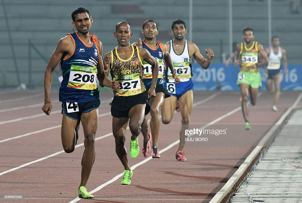 Ajay Kumar Saroj (front) of India runs with other athletes at the men's 1500m event during the 12th South Asian Games 2016 at Indira Gandhi Athletics Stadium in Guwahati on February 11, 2016. AFP PHOTO/ Biju BORO / AFP / BIJU BORO