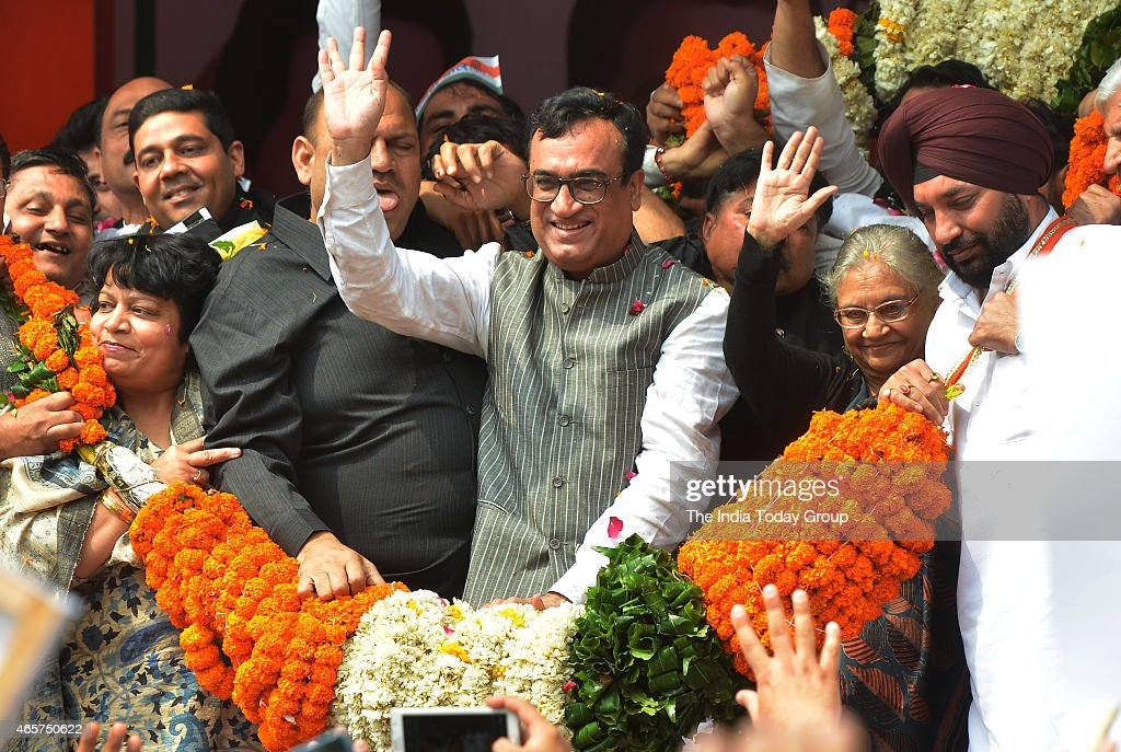 Ajay Maken, with former Delhi Chief Minister <a gi-track='captionPersonalityLinkClicked' href=/galleries/search?phrase=Sheila+Dikshit&family=editorial&specificpeople=728110 ng-click='$event.stopPropagation()'>Sheila Dikshit</a> and other party leaders, is garlanded after taking charge as the Delhi Pradesh Congress Committee chief at a function in New Delhi.