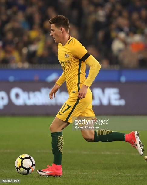 Ajdin Hrustic of Australia runs with the ball during the Brasil Global Tour match between Australian Socceroos and Brazil at Melbourne Cricket Ground...