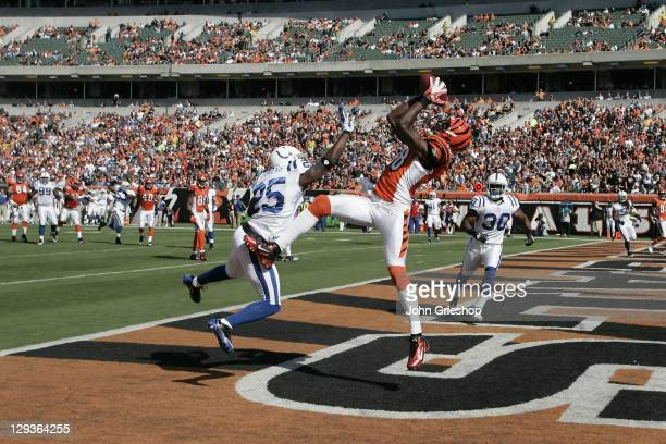 Green of the Cincinnati Bengals makes a touchdown catch against Jerraud Powers of the Indianapolis Colts during their game at Paul Brown Stadium on...