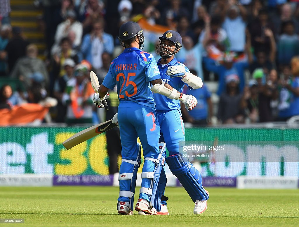 Ajinka Rahane of India celebrates his century with teammate Shikhar Dhawan during the 4th Royal London OneDay International match between England and...
