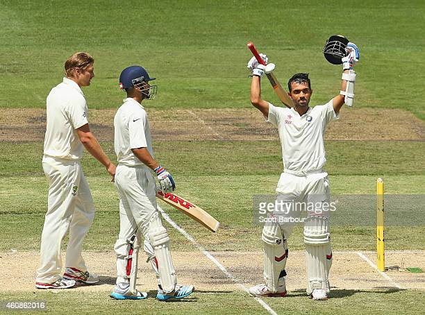 Ajinkya Rahane is congratulated by Virat Kohli of India after reaching his century as Shane Watson of australia looks on during day three of the...