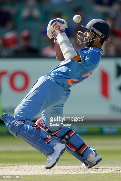 Ajinkya Rahane of India attempts to guide the ball during game three of the One Day International Series between Australia and India at Melbourne...