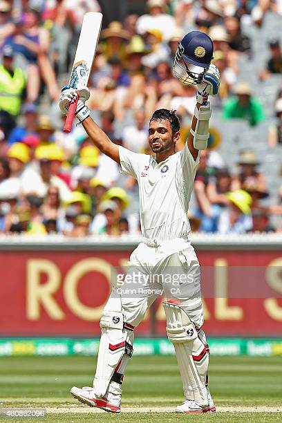Ajinkya Rahane of India celebrates after making his century during day three of the Third Test match between Australia and India at Melbourne Cricket...