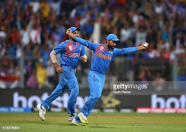 Ajinkya Rahane of India celebrates after taking a catch to dismiss Marlon Samuels of the West Indies off the bowling of Ashish Nehra of India during...