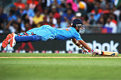 Ajinkya Rahane of India dives trying to avoid a runout during the 2015 ICC Cricket World Cup match between India and Zimbabwe at Eden Park on March...