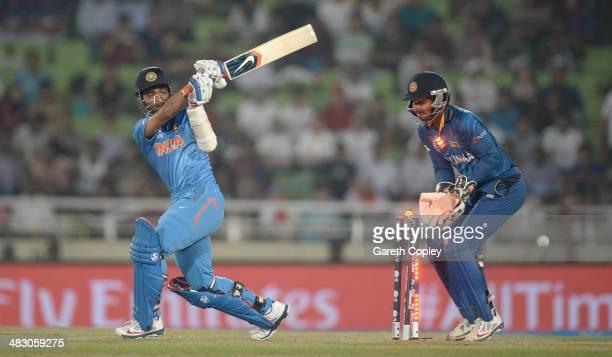 Ajinkya Rahane of India is bowled by Angelo Mathews of Sri Lanka during the ICC World Twenty20 Bangladesh 2014 Final between India and Sri Lanka at...