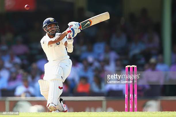 Ajinkya Rahane of India misses the ball which hits his pads during day three of the Fourth Test match between Australia and India at Sydney Cricket...