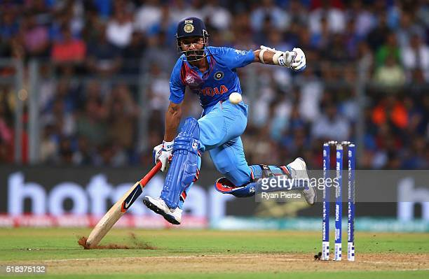 Ajinkya Rahane of India slides his bat to make his ground during the ICC World Twenty20 India 2016 Semi Final match between West Indies and India at...