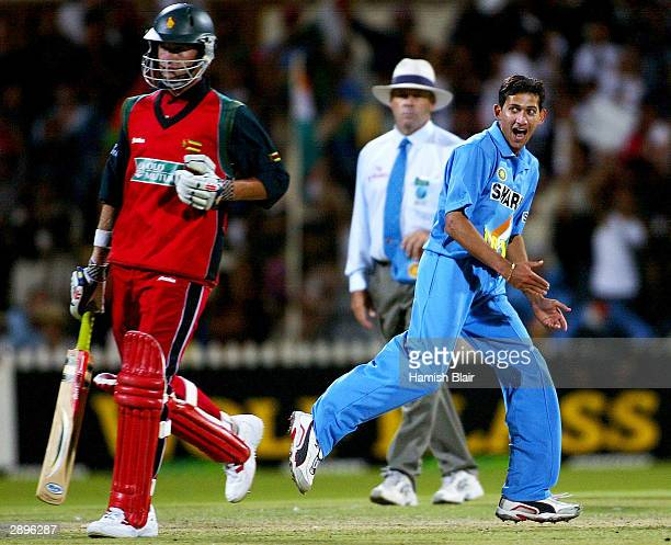 Ajit Agarkar of India celebrates the run out of Sean Ervine of Zimbabwe during the VB Series One Day International between India and Zimbabwe at The...