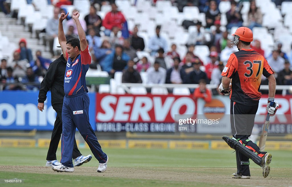 Ajit Akarka of the Daredevils (L) celebrates after taking the wicket of Simon Katich of the Scorchers during Match 15 of The Champions League T20 (CLT20) between the Perth Scorchers (Australia) and Delhi Daredevils (India) at the Newlands Cricket Stadium in Cape Town on October 21, 2012.