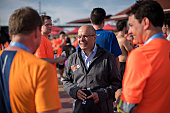 Ajit Jain head of the Berkshire Hathaway reinsurance business speaks to racers during the 'Berkshire Hathaway Invest In Yourself 5K' race presented...