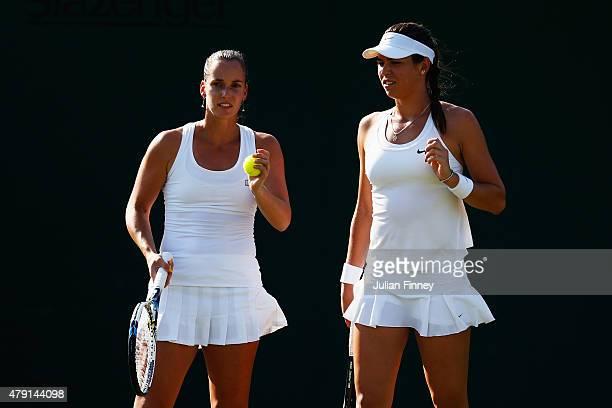 Ajla Tomljanovic of Australia and Jarmila Gajdosova of Australia talk tactics in their Ladies Doubles First Round match against YungJan Chan of...