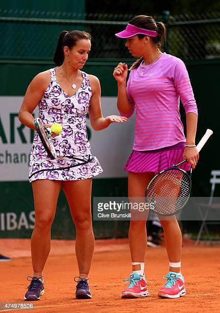 Ajla Tomljanovic of Australia and Jarmila Gajdosova of Australiatalk tactics in their Women's Doubles match against Karolina Pliskova of Czech...