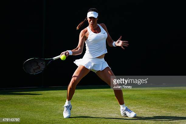 Ajla Tomljanovic of Australia plays a forehand in her Ladies Doubles First Round match with Jarmila Gajdosova of Australia against YungJan Chan of...