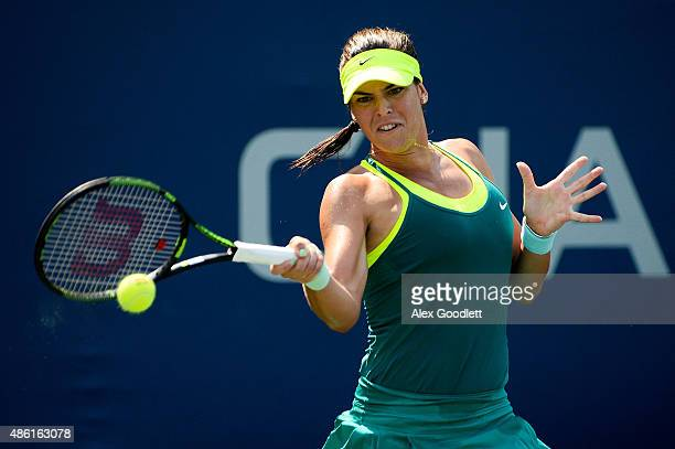 Ajla Tomljanovic of Australia returns a shot against Karin Knapp of Italy during their Women's Singles First Round match on Day Two of the 2015 US...