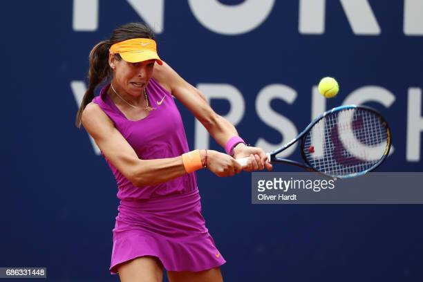 Ajla Tomljanovic of Croatia in action against Kirsten Flipkens of Belgium in the first round during the WTA Nuernberger Versicherungscup on May 21...