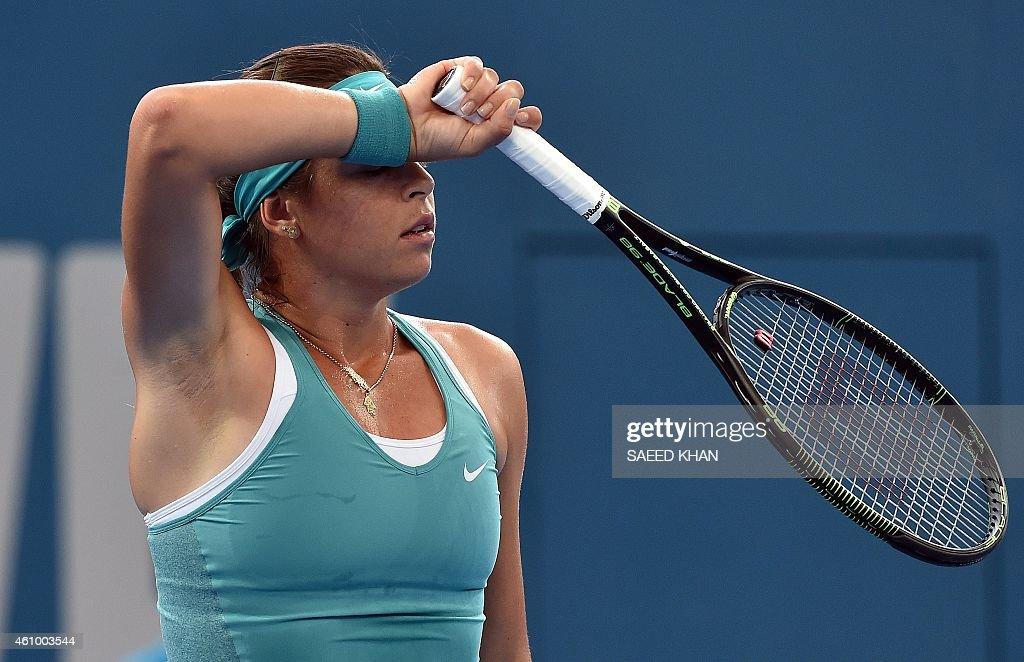 Ajla Tomljanovic of Croatia reacts on a point against Jelena Jankovic Serbia on day one of the Brisbane International tennis tournament in Brisbane on January 4, 2015. AFP PHOTO / Saeed KHAN USE