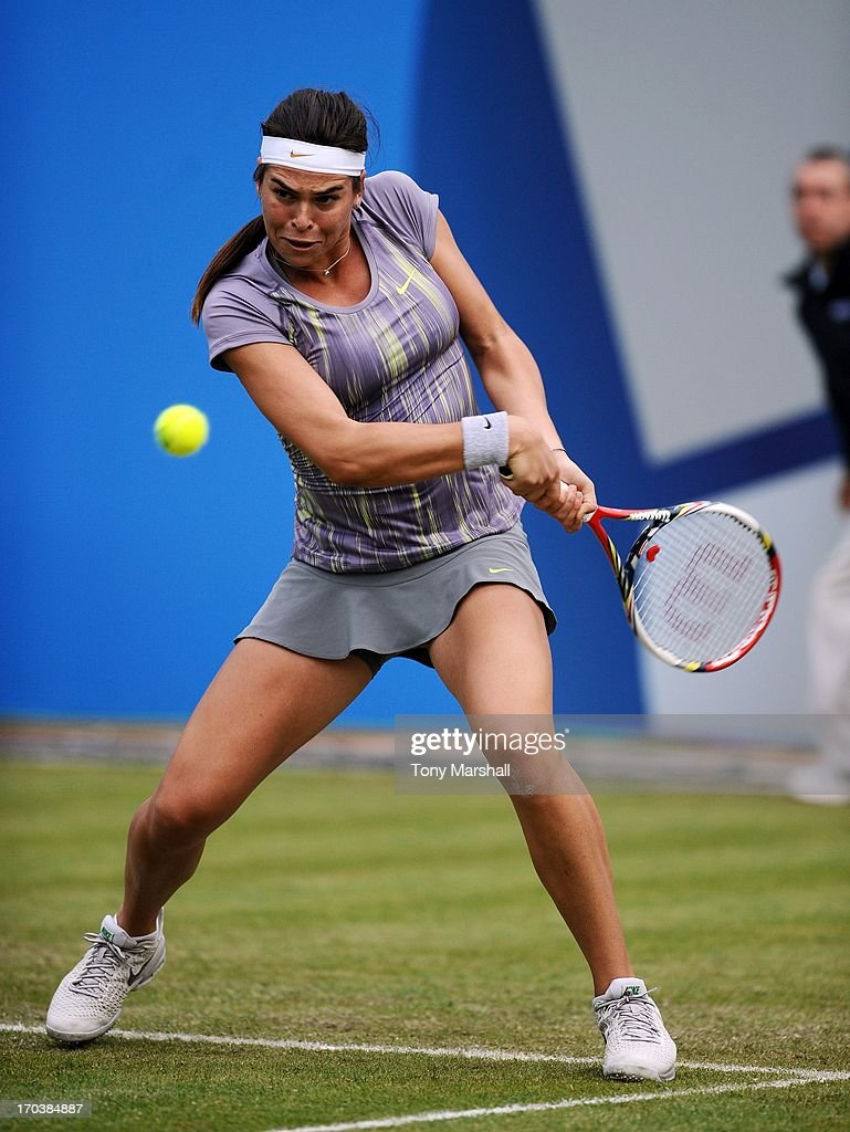 Ajla Tomljanovic of Croatia returns a shot against Kirsten Flipkens of Belguim during the AEGON Classic Tennis Tournament at Edgbaston Priory Club on June 12, 2013 in Birmingham, England.