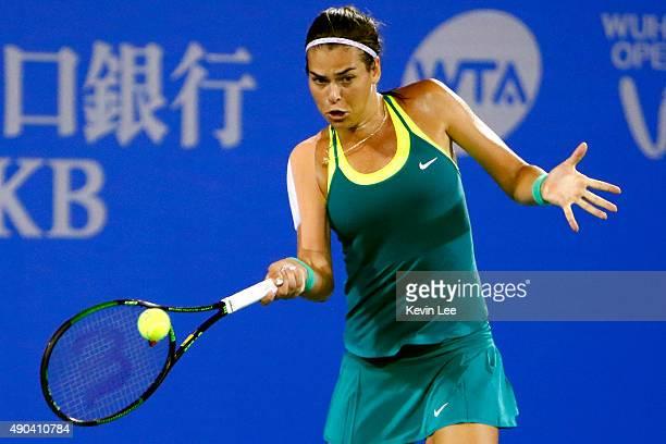 Ajla Tomljanovic of Croatia returns a shot to Belinda Bencic of Switzerland during a match in day 2 of 2015 Dongfeng Motor Wuhan Open at Optics...